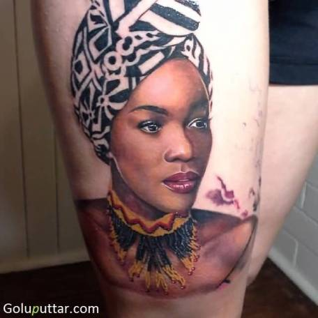 Realistic-African-Women-Tattoo-On-Thigh